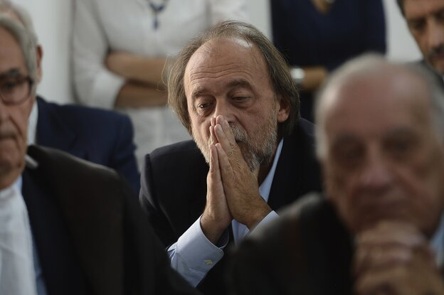 One of the indicted, Bernardo De Bernardinis, who was deputy chief of Italy's Civil Protection Department, reacts during a his tria