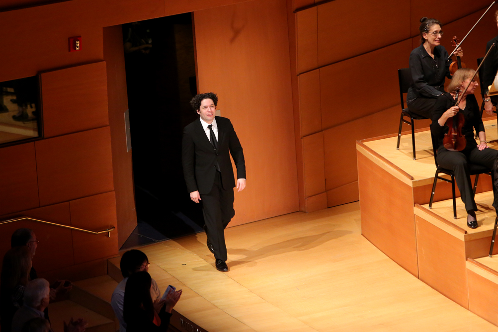 Dudamel comes back onstage to receive the audience's cheers at the end of The Rite of Spring.