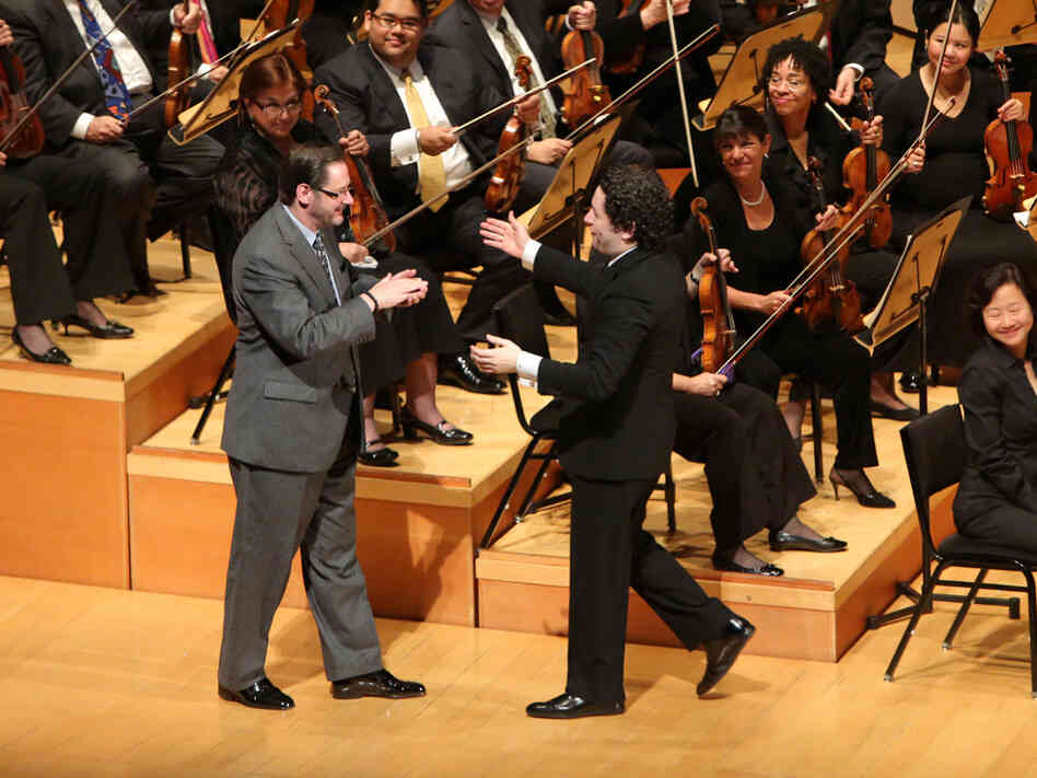 Composer Steven Stucky is warmly greeted by Dudamel after the performance of his newly written Symphony.