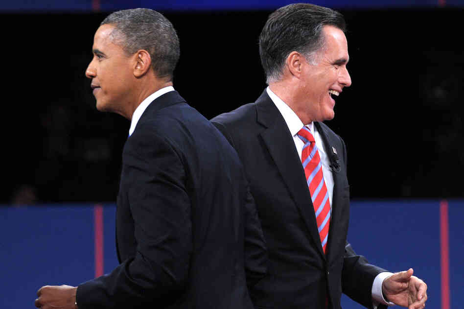 President Obama and GOP presidential nominee Mitt Romney walk away after they greet each other at the end of the third presidential debate in Boca Raton, Fla., on Monday.