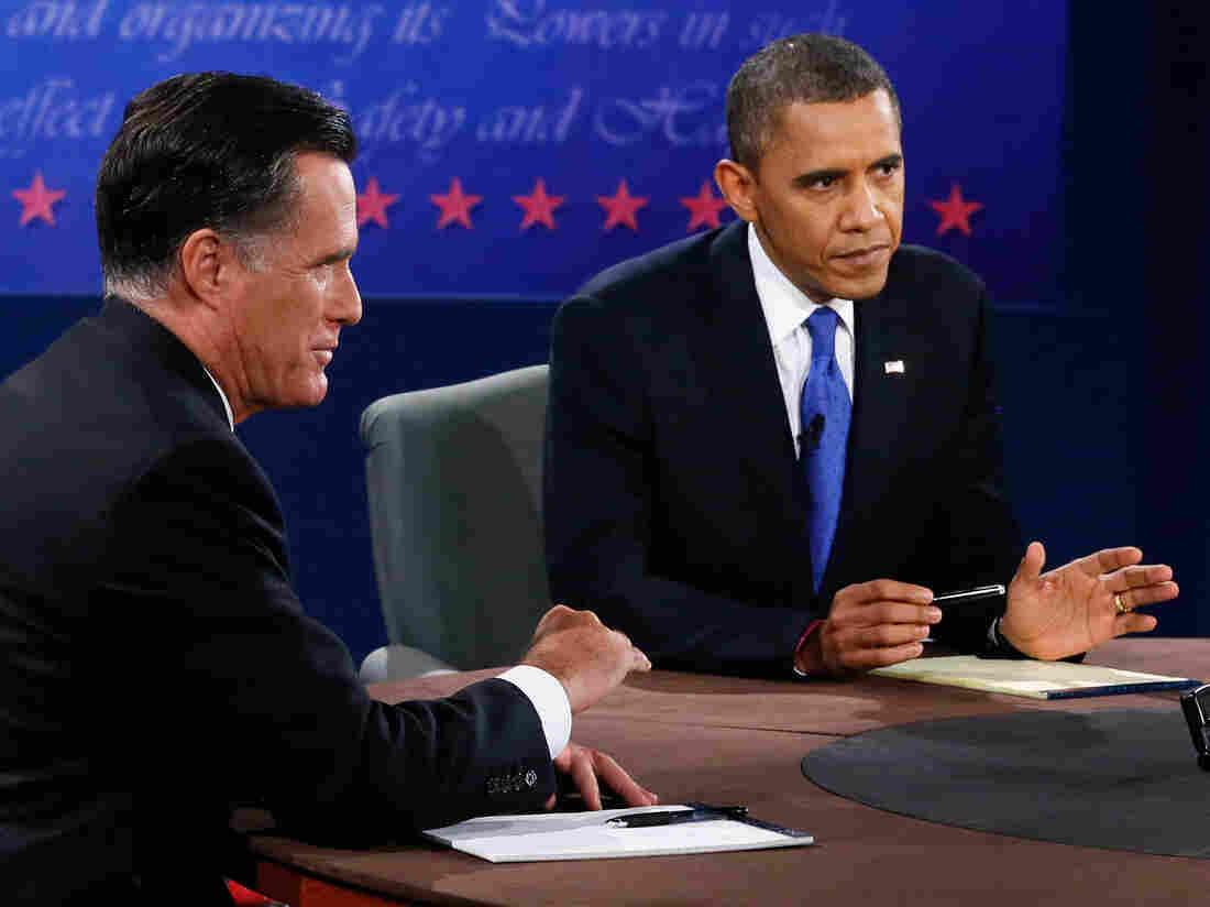 President Obama and former Massachusetts Gov. Mitt Romney at tonight's debate in Boca Raton, Fla.