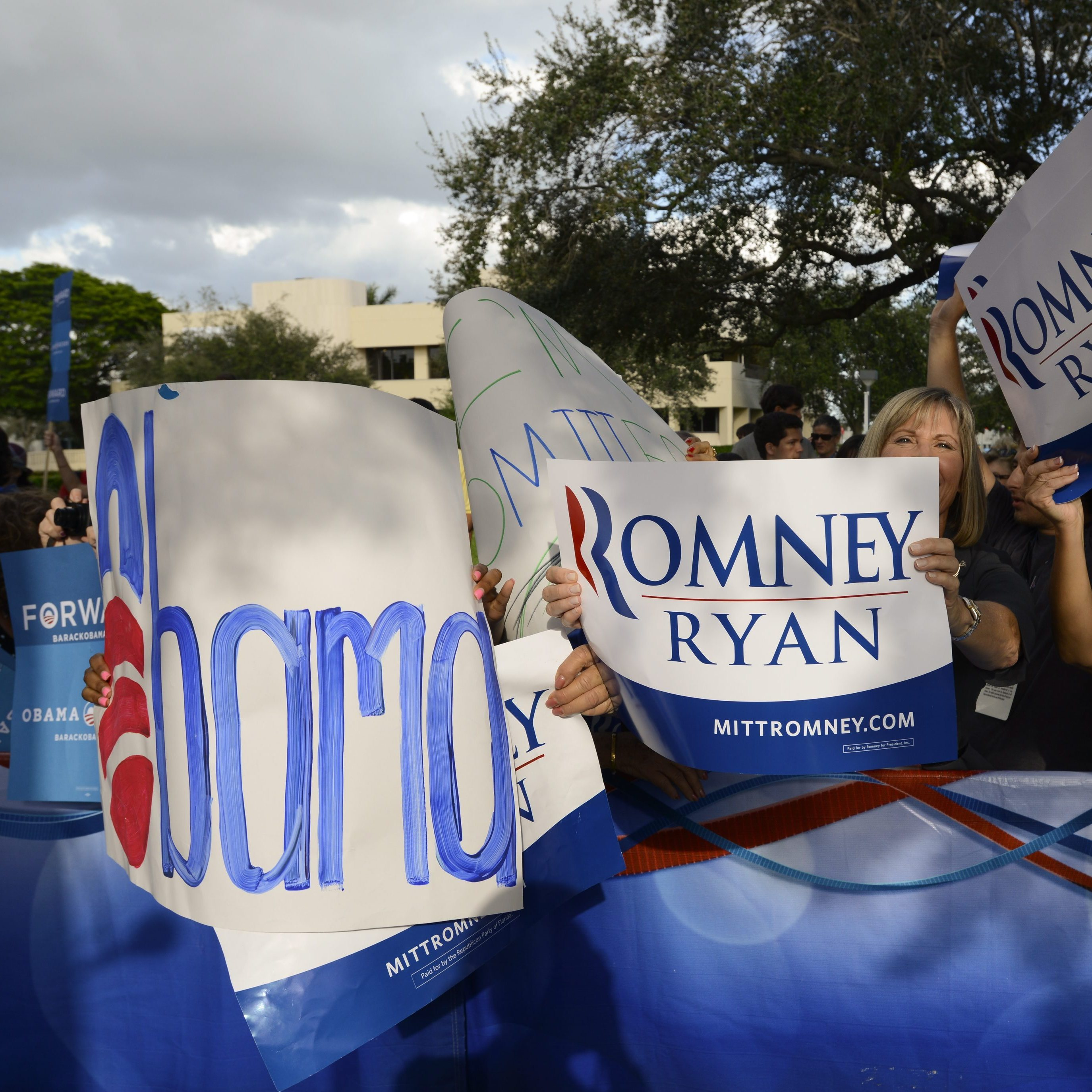 Earlier today in Boca Raton, Fla., supporters of Republican presidential nominee Mitt Romney and President Obama gathered at Lynn University, where tonight's debate is being held.