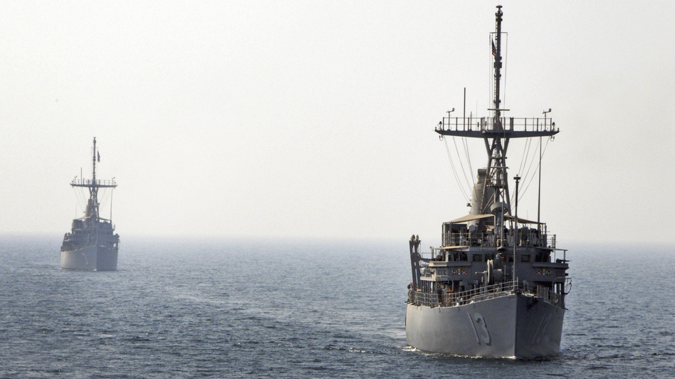 Navy mine countermeasure ships line up in August to conduct a replenishment-at-sea during Middle East Gulf naval exercises in this photo provided by the U.S. Navy, 5th Fleet.