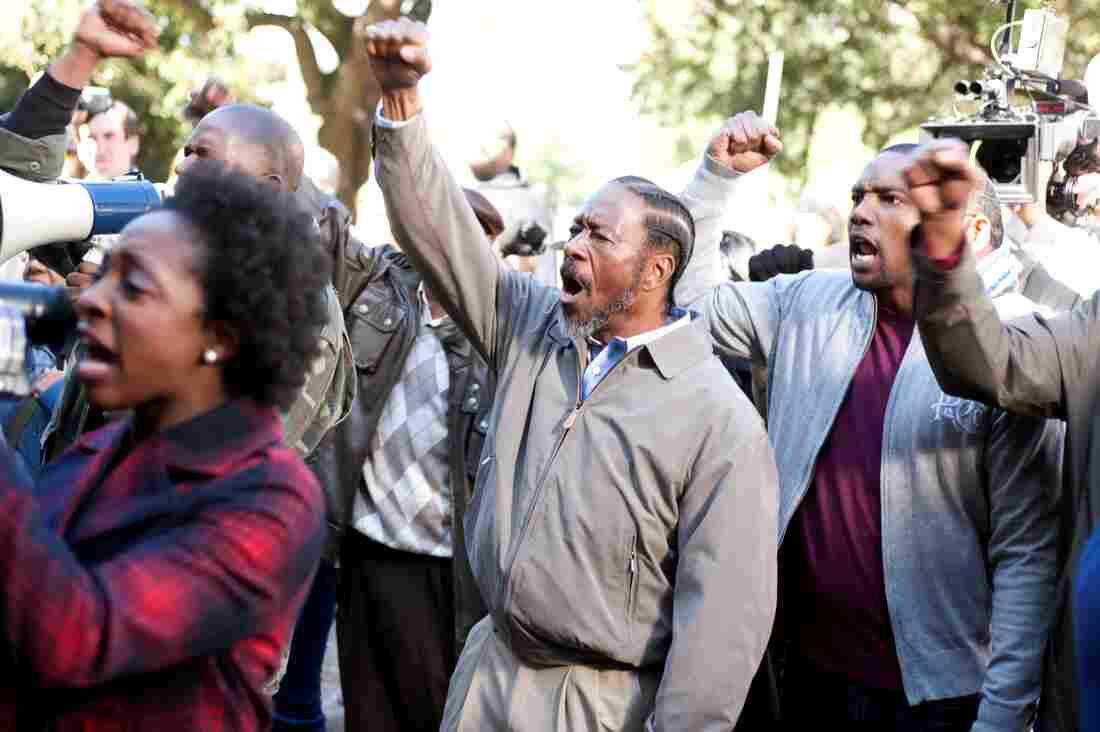 The Lambreaux men protest the demolition of housing projects.