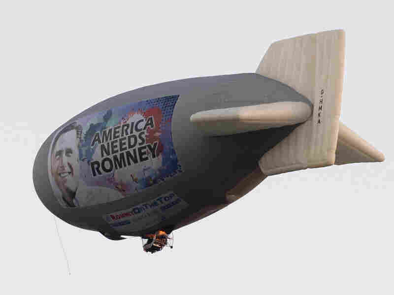 A blimp with a message in support of Republican presidential nominee Mitt Romney flies over Plantation, Fla., on Sunday.