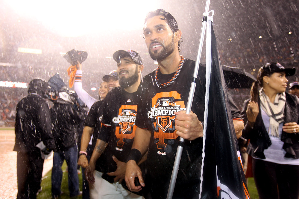 Angel Pagan #16 of the San Francisco Giants celebrates after the Giants 9-0 victory against the St. Louis Cardinals in Game Seven of the National League Championship Series in San Francisco, California.