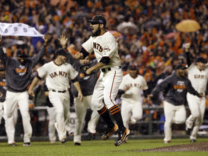 San Francisco Giants relief pitcher Sergio Romo reacts after the final out in Game 7 of baseball's Nation