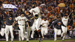 San Francisco Giants relief pitcher Sergio Romo reacts after the final out in Game 7 of baseball's National League Championship Series against th
