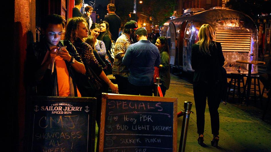 Festival-goers outside of Arlene's Grocery on New York City's Lower East Side during the CMJ Festival on Oct. 18, 2012.