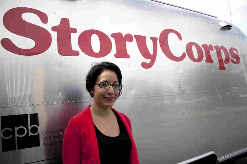 StoryCorps facilitator Virginia Lora stands next to the MobileBooth trailer parked outside the Columbia Pike Branch Library and Career Center in Arlington, Va.