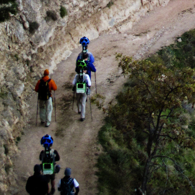 The Google Trekker team hikes down the Bright Angel trail heading toward the base of the Grand Canyon.