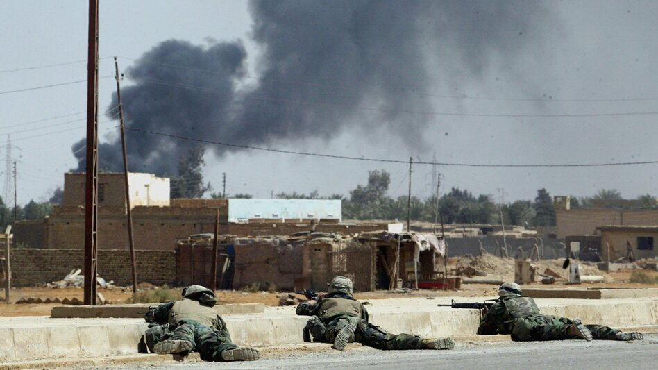 A scene from the early days of the fighting in Iraq in the spring of 2003. In one incident, three members of an Iraqi family were killed. A U.S. Marine involved in the shooting recently tracked down the family to ask for forgiveness.