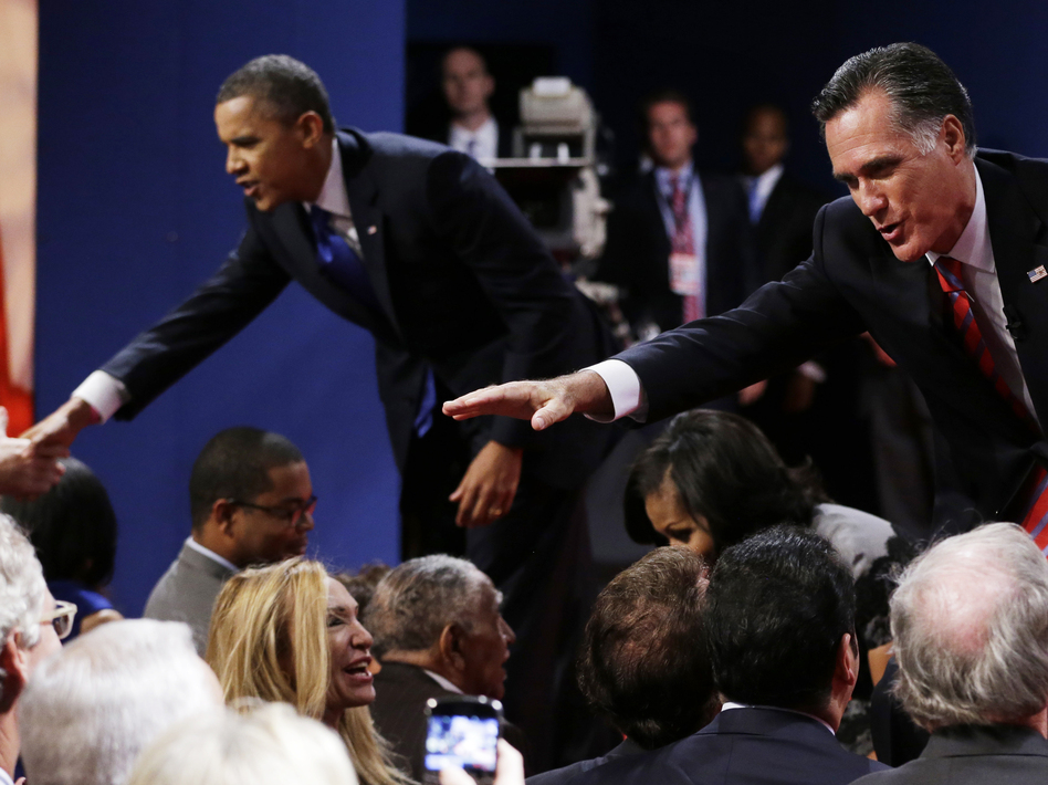 Republican presidential nominee Mitt Romney and President Obama shake hands with audience members following the third presidential debate Monday at Lynn University in Boca Raton, Fla. (Eric Gay/AP)