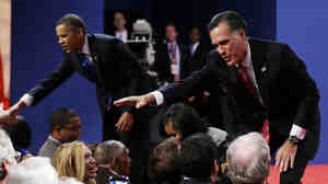 Republican presidential nominee Mitt Romney and President Obama shake hands with audience members following the third presidential debate Monday at Lynn University in Boca Raton, Fla.