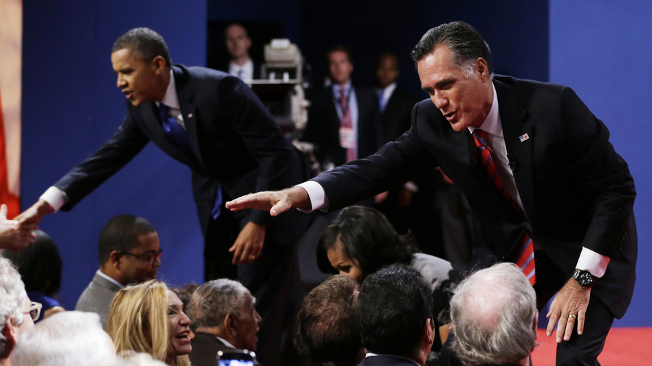 Republican presidential nominee Mitt Romney and President Obama shake hands with audience members following the third presidential debate Monday at Lynn University in Boca Raton, Fla. (AP)
