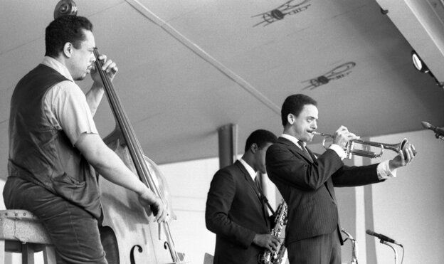 Bassist Charles Mingus leads a band at the 1964 Monterey Jazz Festival, including Lonnie Hillyer (trumpet) and Charles McPherson (alto sax, obscured).