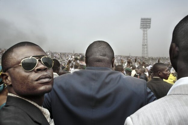"The photos in his series Congo Democratic ""trace some aspects of the individuals and institutions that have been in power in the Congo,"" writes photographer Guy Tillim. Here, presidential candidate Jean-Pierre Bemba enters a stadium in central Kinshasa flanked by his bodyguards during an election rally."