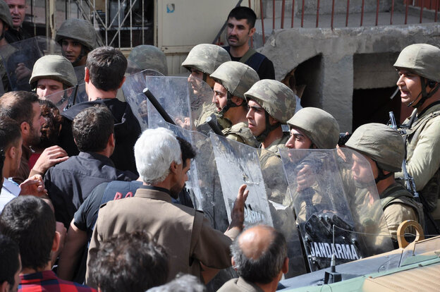 Turkish soldiers block a street as Kurds demonstrate on September 3 in the center of Beytussebap, about 25 miles from the Iraqi border.