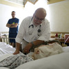Dr. Joel Policzer checks on his patient, Lillian Landry, in the hospice wing of an Florida hospital in 2009. A new study found that many terminally ill cancer patients don't fully understand their prognosis.