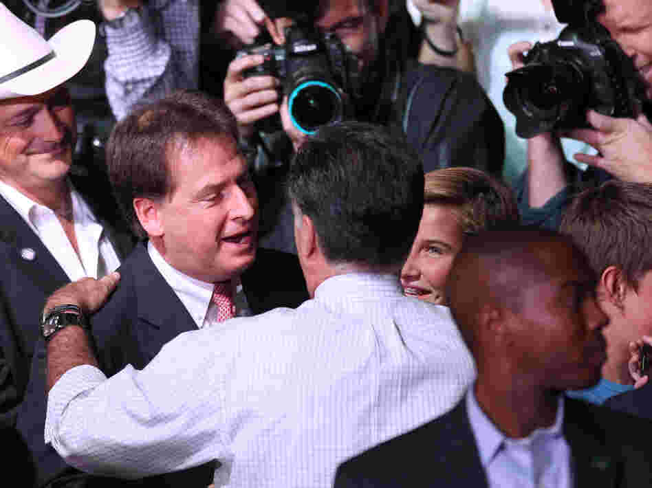 Republican presidential nominee Mitt Romney greets Nevada Lt. Gov. Brian Krolicki, center, following a rally in Reno, Nev., Wednesday.
