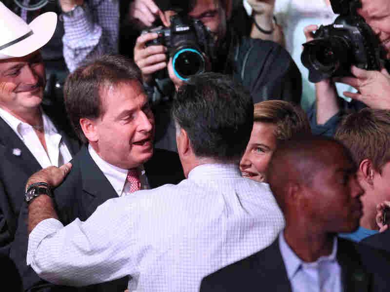 Republican presidential nominee Mitt Romney greets Nevada Lt. Gov. Brian Krolicki, center, following a rally in Reno, Nev., Wednesday.