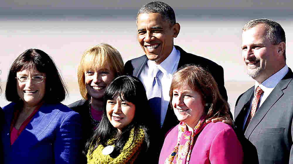 President Obama pauses for a photo with supporters after arriving for a campaign stop in Manchester, N.H., on Thursday.