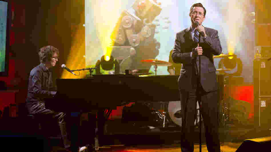 Stephen Colbert (right) performs with Ben Folds on the set of his TV show, The Colbert Report.