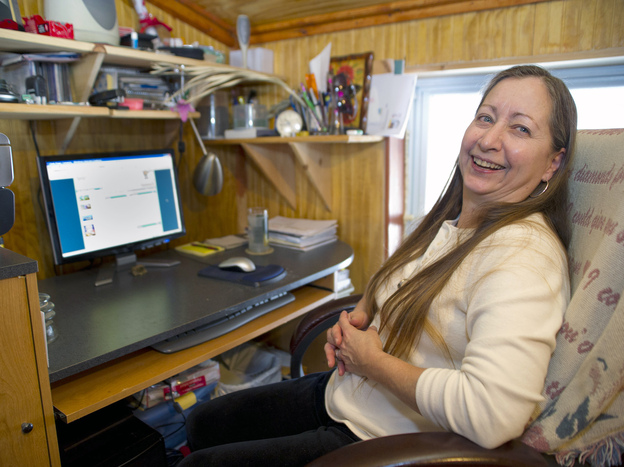 In much of America, the availability of online video is often frustrated by slow broadband speeds. In this 2011 photo, Valerie Houde waits for a dial-up Internet connection in East Burke, Vt.