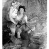 Actors Stan Laurel and Edna Marlon play at socializing around the campfire. It turns out that early man's brain developed in part thanks to cooking.