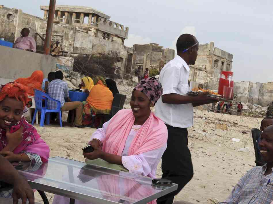 Somalis chat at a beach-side restaurant earlier this month. After two decades of civil war, Somali's capital, Mogadishu, is beginning to recover.