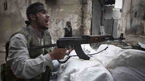 In Aleppo, Syria, an opposition fighter shouted as he manned a position on Monday.