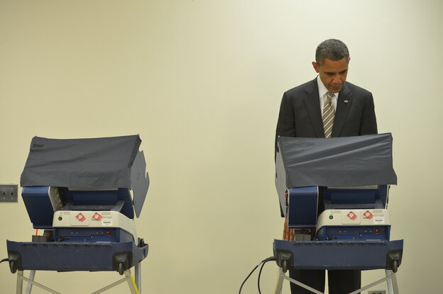 President Obama casts his early ballot on at the Martin Luther King Community Center in Chicago.