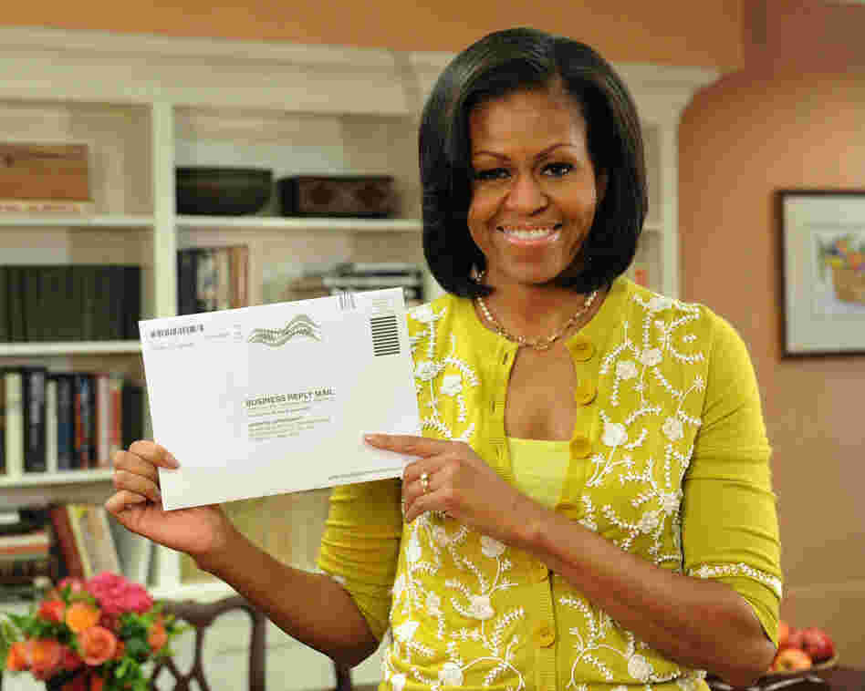 First Lady Michelle Obama prepares her absentee ballot for the upcoming elections.