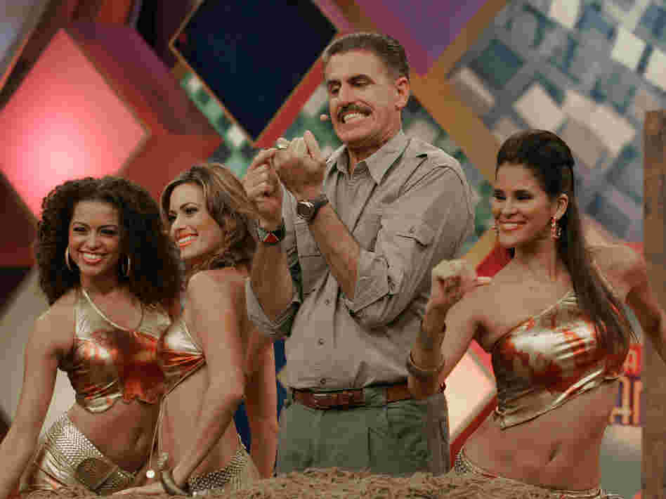 Zoologist Ron Magill points to his wedding ring as dancers surround him during a 2006 taping of Sábado Gigante.
