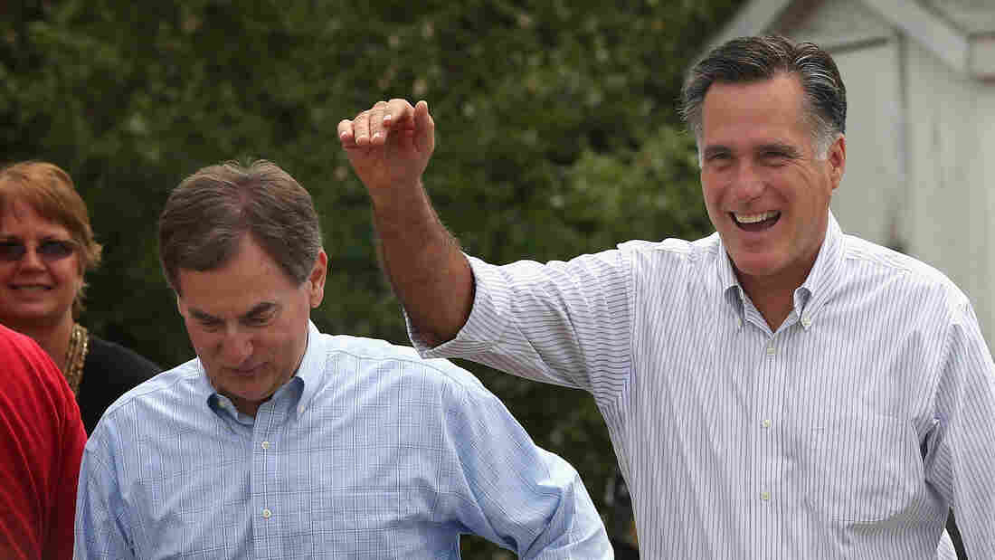 Republican presidential candidate Mitt Romney greets supporters at an Indiana campaign event with U.S. Senate candidate Richard Mourdock in August. Mourdock has come under fire for controversial comments about rape.