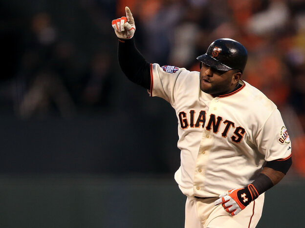 San Francisco Giants third baseman Pablo Sandoval rounding the bases after one of his three home runs last night.