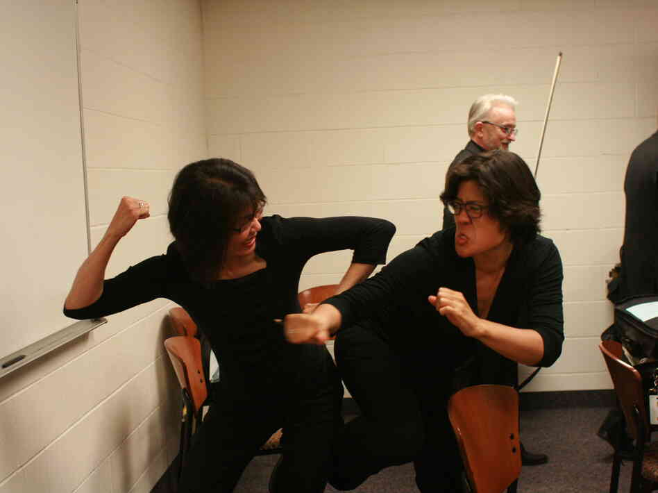 St. Paul Chamber Orchestra violists Evelina Chao and Maiya Papach wage battle in happier times.