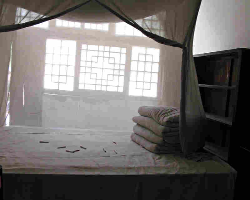 As a tribute to Mao, enthusiastic tourists have thrown cigarettes onto the bed in his former cave dwelling.