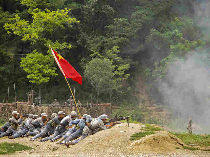 """Tourists can dress up and take part in """"The Defense of Yan'an,"""" a re-enactment of a 1947 Chinese Civil War battle to protect the revolutionary base from the Nationalists, who fled to Taiwan."""