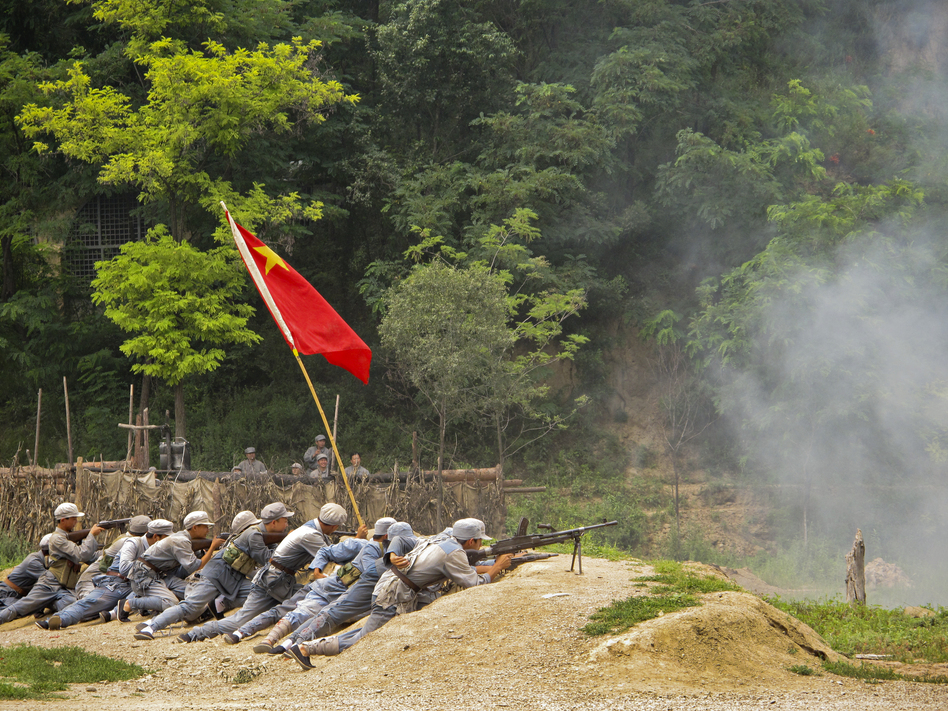 "Tourists can dress up and take part in ""The Defense of Yan'an,"" a re-enactment of a 1947 Chinese Civil War battle to protect the revolutionary base from the Nationalists, who fled to Taiwan.  (NPR)"