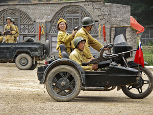 Other tourists wear the mustard-colored uniforms of the Nationalists led by Chiang Kai-shek, the Chinese Communists' opponents in the country's civil war.