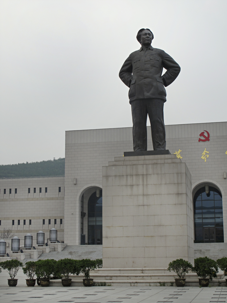 A statue of Mao — who spent 13 years in Yan'an building up support for the communist revolution — stands in front of the Yan'an Revolutionary Memorial Hall, which cost $80 million to build and opened in 2009.  (NPR)