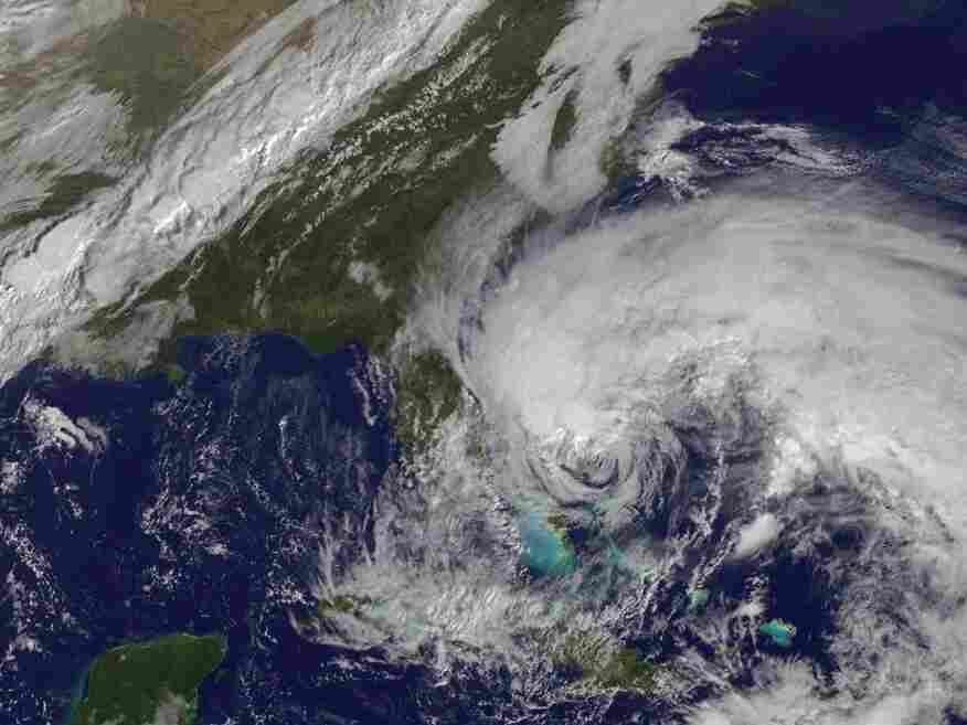In this satellite image provided Friday by the National Oceanic and Atmospheric Administration, Hurricane Sandy's huge cloud extent of up to 2,000 miles churns over the Bahamas,