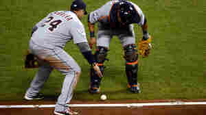 Please go foul, please go foul, please go foul: Third-baseman Miguel Cabrera (No. 24) and catcher Gerald Laird of the Detroit Tigers watched closely to see if a bunt by the Giants' Gregor Blanco would go foul Thursday night in San Francisco. It didn't. The Giants scored and went on to win the game and take a 2-0 lead in the World Series.