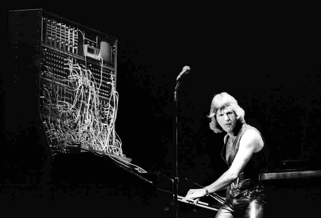 I think we can all agree that he deserves at least a little bit of the blame: Keith Emerson of Emerson, Lake & Palmer on stage with his Moog synthesizer.