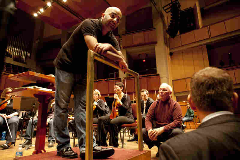 "Bahl (left) speaks with Neil (center) and Weiler about the organ's test performance with the orchestra on Oct. 18. After six weeks of toning and tuning, the team just needed to make a few final refinements. ""We had to tone it down today. We heard too much organ,"" said Weiler. ""It's much easier to make an organ softer than louder, but the power is there."""