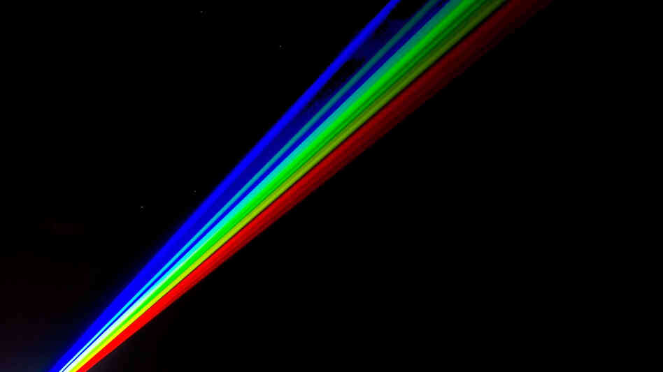 This laser's just pretty, not powerful: Artist Yvette Mattern's laser rainbow in Whitley Bay, England, earlier this year.