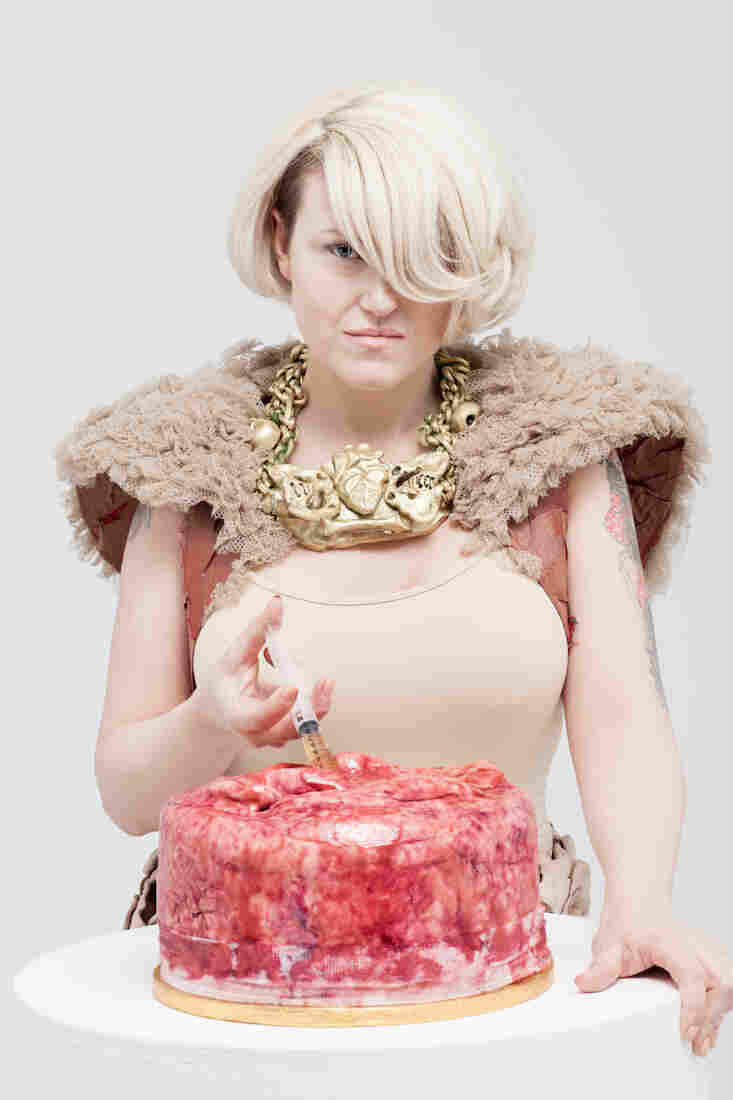 Festival organizer, pathologist, and baker Carla Connolly injects a cake make to look like human flesh in this promotional shot for the museum's bake sale.