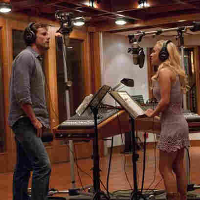 Nashville veteran Deacon (Charles Esten) and upstart country-pop star Juliette (Hayden Panettiere) record a duet in a scene from ABC's Nashville.