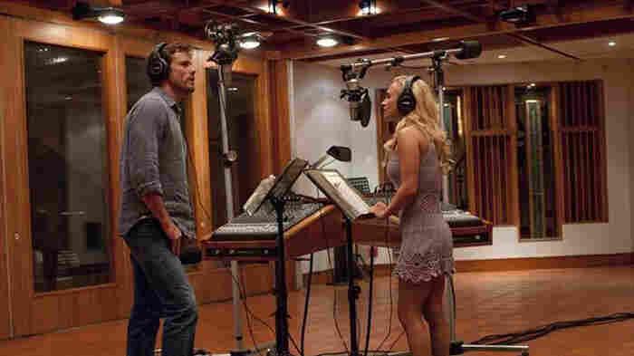Nashville veteran Deacon (Charles Esten) and upstart country-pop star Juliette (Hayden Panettiere) record a duet in a scene from ABC's Nashville.